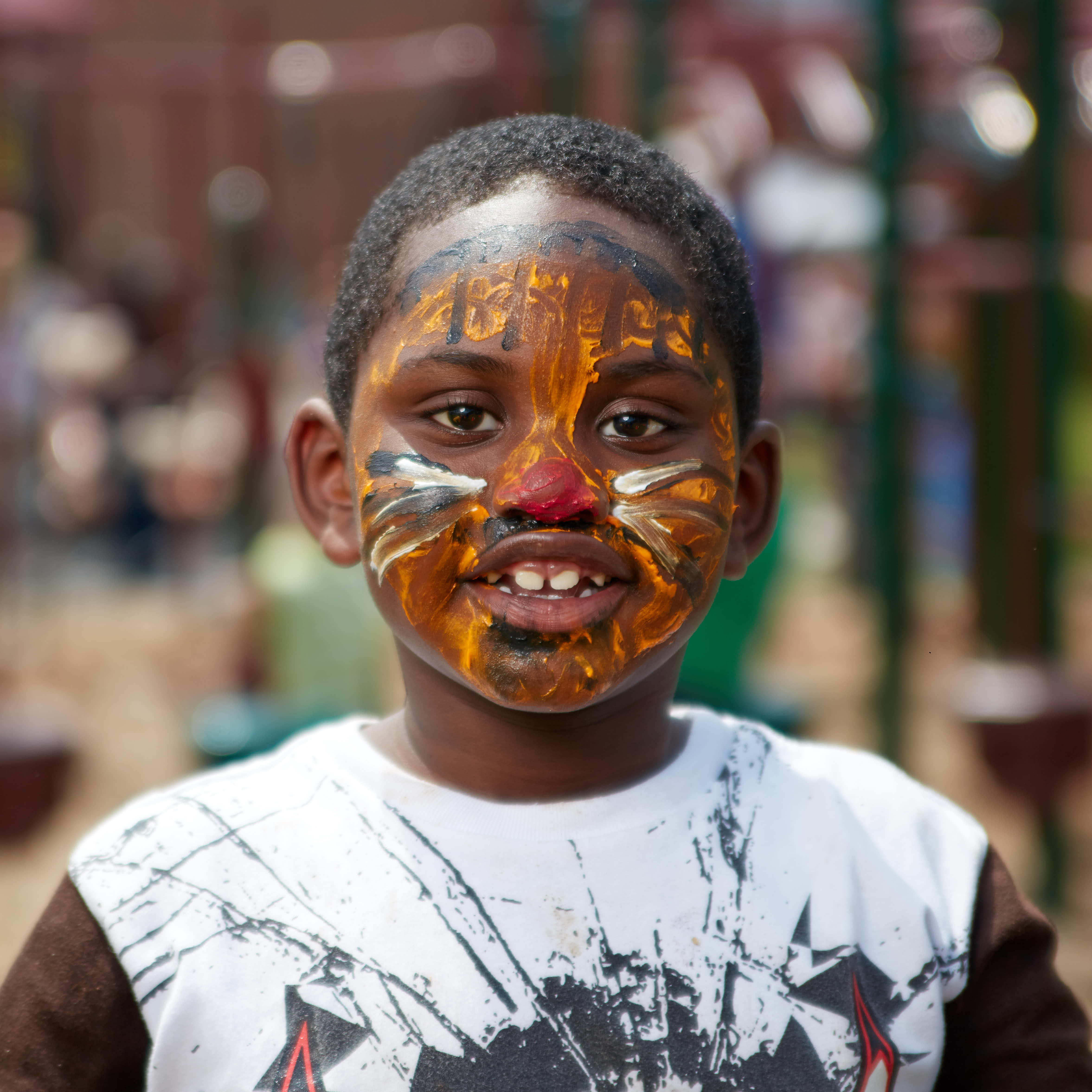 Young boy with his face painted